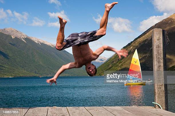 Lake Rotoiti is lake in the Tasman Region of New Zealand. It is a mountain lake within in the Nelson Lakes National Park. This man jumps off the end of the bridge into the cold water
