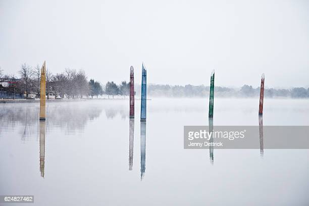 Lake sculptures in fog