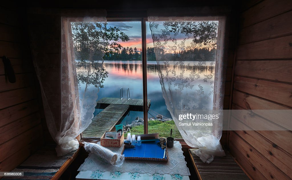 Lake seen from a traditional sauna window : Stock Photo