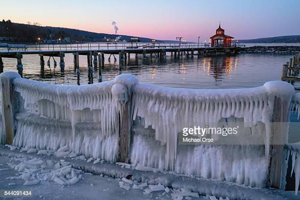 lake seneca pier watkins glen. winter frozen ice cold. - finger lakes stock pictures, royalty-free photos & images