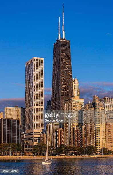 Lake Shore Drive condominiums and the John Hancock Tower located on the Gold Coast are viewed at sunrise on October 10 2015 in Chicago Illinois...