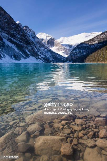lake shore lake louise canadian rockies - glacier lagoon stock photos and pictures