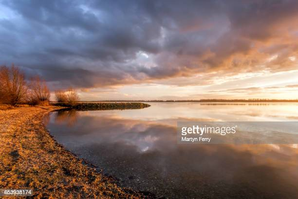 Lake shore stormy sunset, Grafham Water, Cambridgeshire, East Anglia, UK