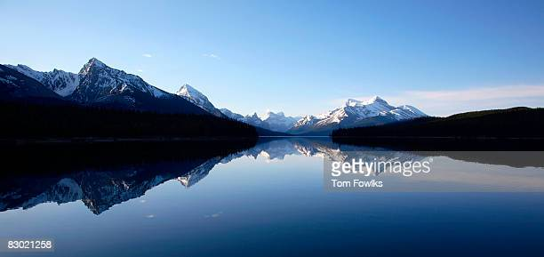 lake surrounded by mountains - symmetry stock pictures, royalty-free photos & images