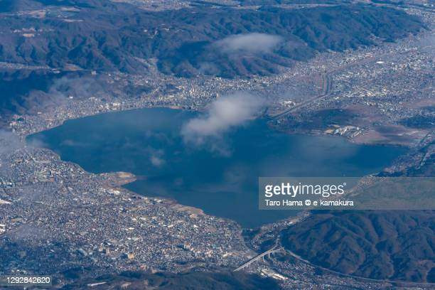 lake suwa in nagano prefecture japan aerial view from airplane - 諏訪市 ストックフォトと画像