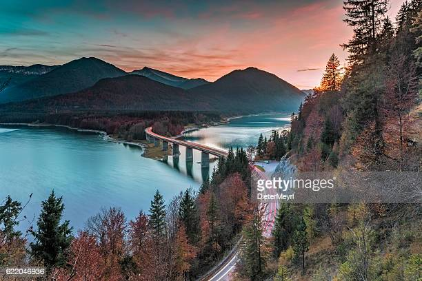 lake sylvester - sylvensteinspeicher at autmun - european alps stock photos and pictures