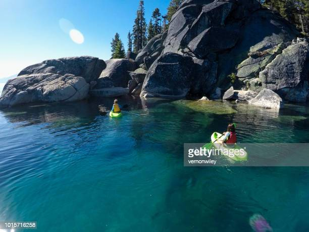 lake tahoe kayaking in crystal clear water - lake tahoe stock photos and pictures