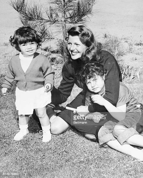 Seventeenmonthsold Yasmin daughter of actress Rita Hayworth and Prince Aly Khan is shown playing with her famous mother and sixyearold halfsister...