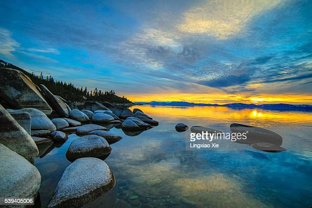 lake tahoe sunset and reflection, california, usa - lake tahoe stock photos and pictures