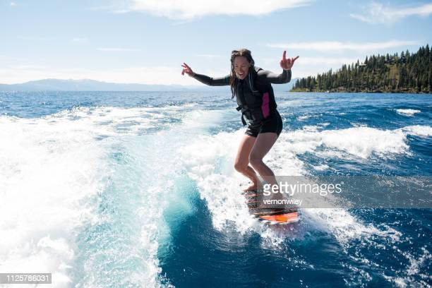 lake tahoe wake surfing party - lake tahoe stock pictures, royalty-free photos & images