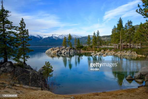 lake tahoe with snow capped mountain - lake tahoe stock photos and pictures