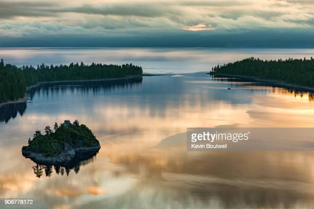 lake tahoe's emerald bay at sunrise - emerald bay lake tahoe stock pictures, royalty-free photos & images