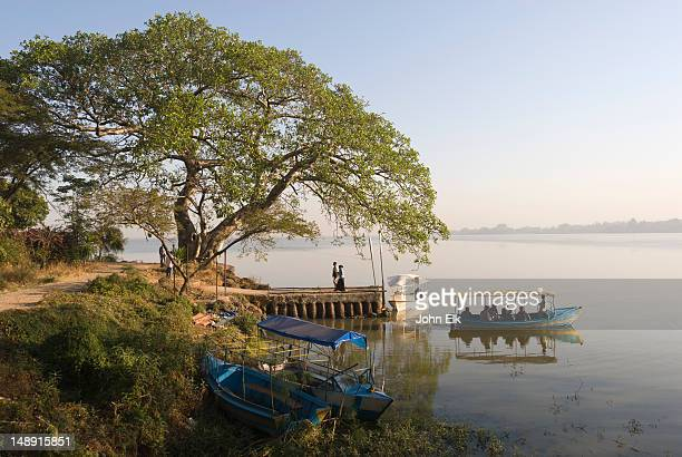 Lake Tana landscape with boats and small dock.
