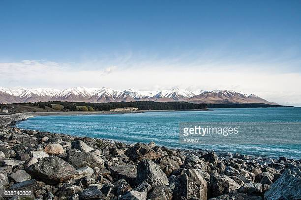lake tekapo and the snow-capped mountains - vsojoy stock pictures, royalty-free photos & images