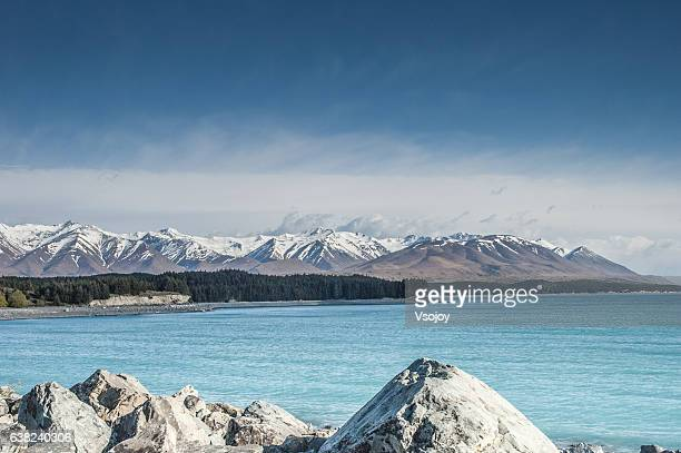lake tekapo framed by the southern alps - vsojoy stock pictures, royalty-free photos & images