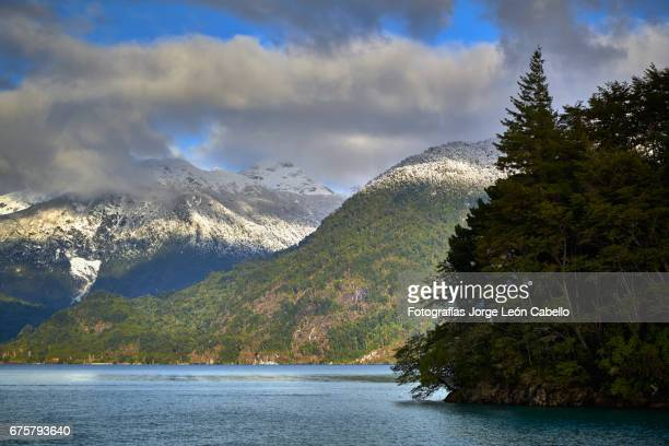 lake todos los santos surrounding winter view during the andean lake crossing - azul turquesa stock pictures, royalty-free photos & images