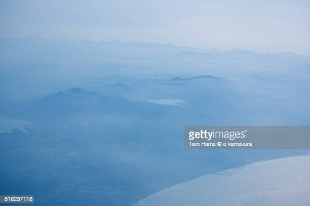 Lake Usori and Mt. Osorezan, sacred place in Aomori prefecture daytime aerial view from airplane