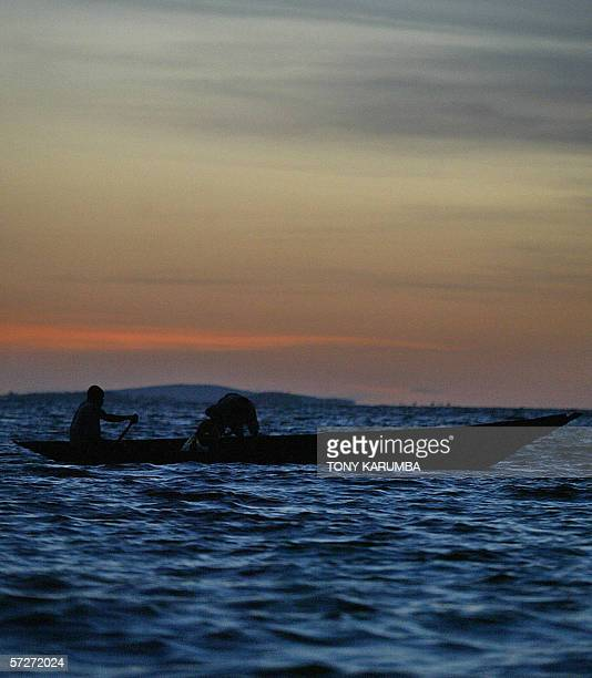TO GO WITH AFP STORY Fishermen set their nets during a fishing expedition in the waters of Africa's largest fresh water body Lake Victoria 29 March...