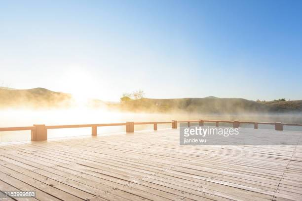 lake view and viewing platform at sunrise - observation point stock pictures, royalty-free photos & images