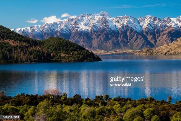 lake wakatipu and the southern alps, otago, new zealand - queenstown stock pictures, royalty-free photos & images