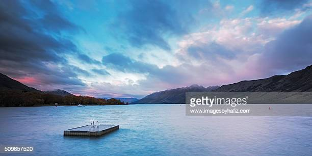 lake wakatipu during sunrise - barge stock photos and pictures