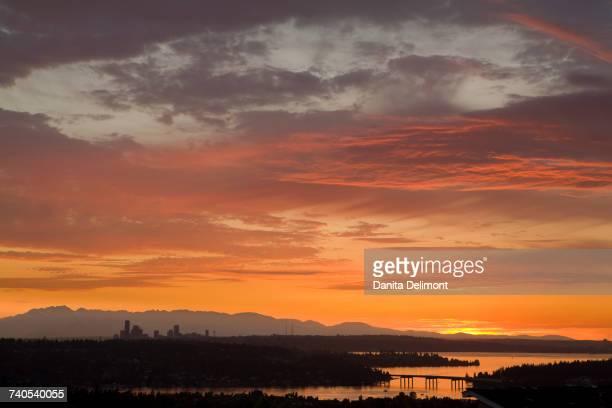 lake washington and olympic mountains at sunset, bellevue, seattle, king county, washington state, usa - bellevue washington state stock photos and pictures