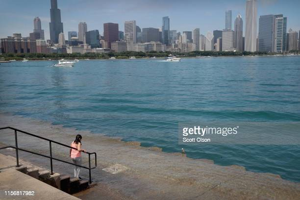 Lake water washes over a concrete bike and jogging path along Lake Michigan on June 18, 2019 in Chicago, Illinois. Recent rains have caused the water...