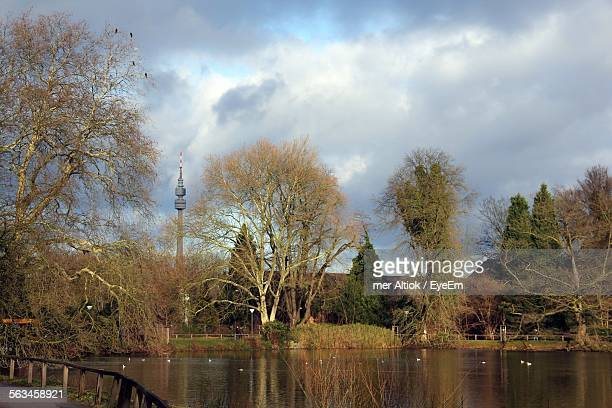 lake with communication tower in background - dortmund stock pictures, royalty-free photos & images