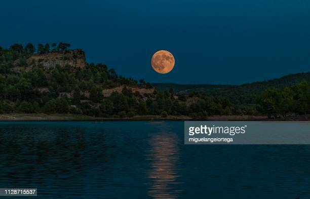 Lake with full moon in spanish mountains