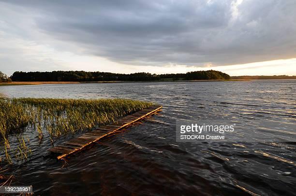 Lake with jetty at dusk, Masuria, Poland
