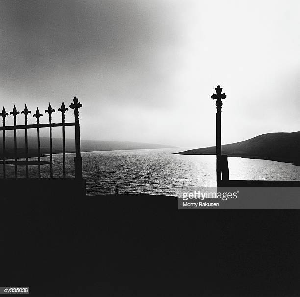 lake with ornate fence in foreground - monty rakusen stock pictures, royalty-free photos & images