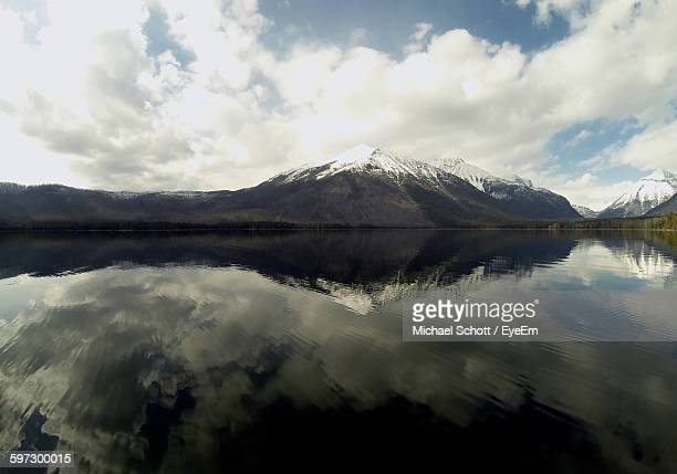 Lake With Reflection By Mountains Against Sky