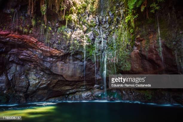 lake with waterfall in madeira - madeira fotografías e imágenes de stock