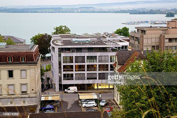 Lake Zug is seen beyond the building that houses the headquarters of Xstrata Plc, center, in Zug, Switzerland, on Friday, Aug. 24, 2012. Glencore's...
