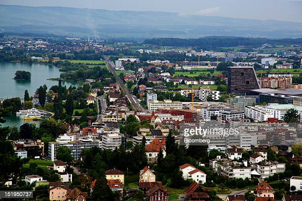 Lake Zug left is seen next to commercial and residential buildings in Zug Switzerland on Friday Aug 24 2012 Farmer Philipp Freimann took just a few...