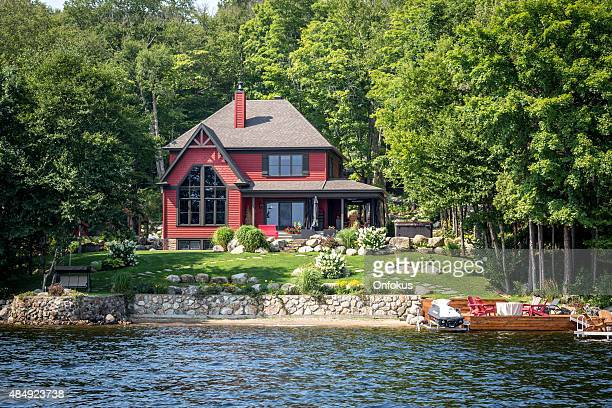 lakefront luxury property on sunny day of summer - promenade stock pictures, royalty-free photos & images