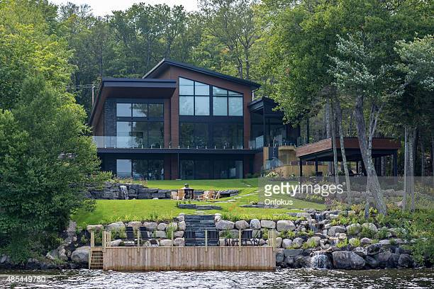lakefront luxury property on sunny day of summer - stereotypically upper class stock pictures, royalty-free photos & images