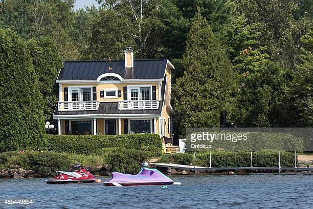 lakefront luxury property on sunny day of summer - waterfront stock pictures, royalty-free photos & images