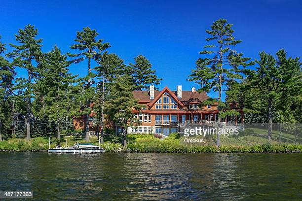 lakefront property on sunny day of summer - waterfront stock pictures, royalty-free photos & images