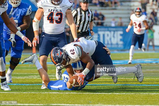 La'Kel Bass recovering a fumble during the NCAA football game between the UTSA Roadrunners and the MTSU Blue Raiders on November 5 at Johnny Red...