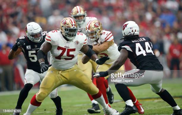 Laken Tomlinson of the San Francisco 49ers blocks as Trey Lance rushes during the game against the Arizona Cardinals at State Farm Stadium on October...