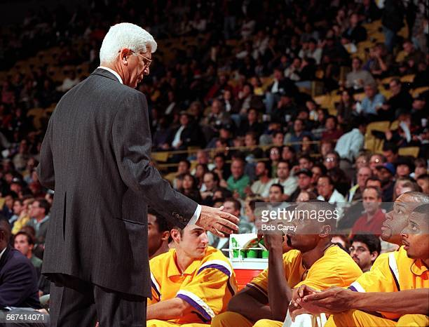 Laker coach Del Harris talks with bench players including from left Jon Barry Corie Blount Sean Rooks and Mario Bennett during game against the...