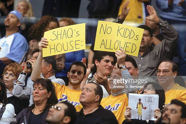 Laker fans hold up Shaq signs during the NBA game between the Los Angeles Lakers and the New Jersey Nets at Staples Center on January 24 2003 in Los...