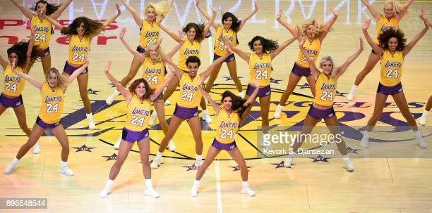 Laker Girls perform wearing one of the numbers of Los Angeles Lakers legend Kobe Bryant jersey which was retired during the basketball game between...