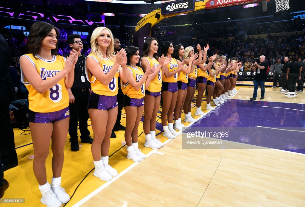 Laker Girls wear the number 8 Kobe Bryant jersey during a ceremony ...