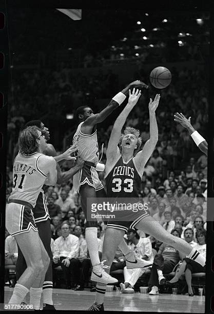 LA Laker guard Michael cooper goes over Boston Celtic forward Larry Bird and blocks his shot during 2nd period action