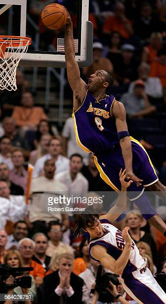 Laker Kobe Bryant goes for the dunk over the Phoenix Suns Steve Nash in the fourth quarter with emphasis in game two of the NBA Western Conference...