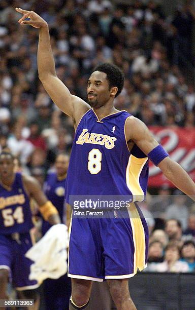 Laker Kobe Bryant holds his pose after shooting a 3–point shot to cinch the win over the Spurs during Game 2 of the Western Conference Playoffs in...