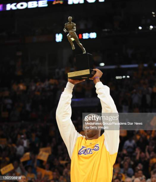Laker Kobe Bryant holds up the MVP trophy before game two of the the Western Conference Semi final playoff's between the Utah Jazz and the Los...