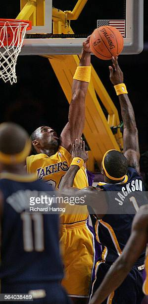 Indiana pacer center getty images laker kobe bryant left gets up high to block a shot by indiana pacer stephen jackson voltagebd Images